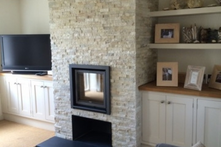 Stuv 16 in Bespoke stone fireplace