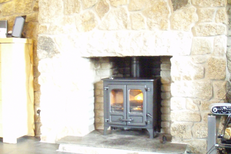 Charnwood Island in a traditional stone fireplace