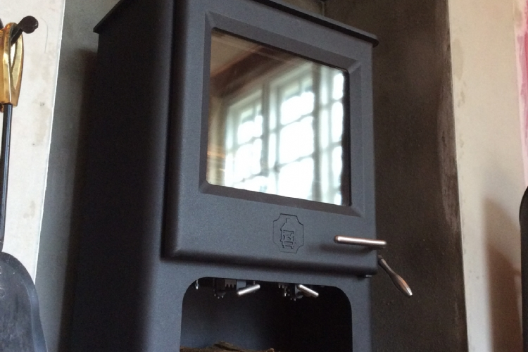 Replacing a fake Victorian fireplace with a wood burning stove