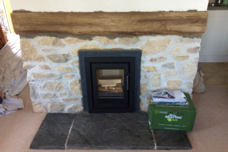 Replacing an open fire in a modernised cottage