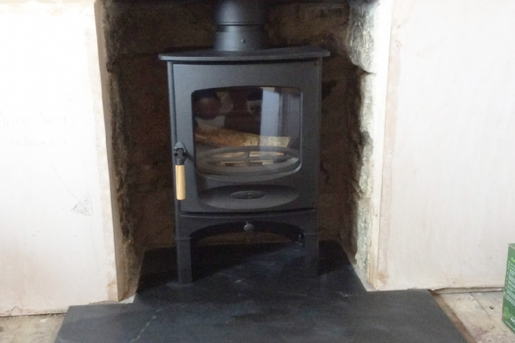 Charnwood C 4 in a stone fireplace