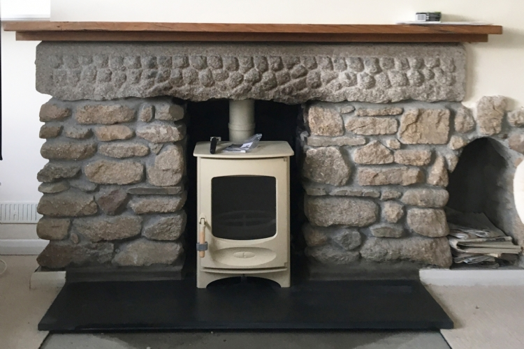 Charnwood C4 in a cosy stone fireplace