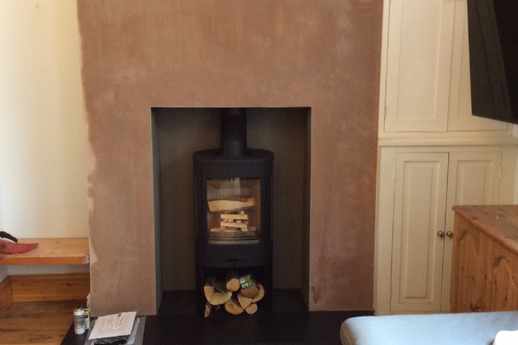 Contura 810 in freshly plastered fireplace in Cornwall
