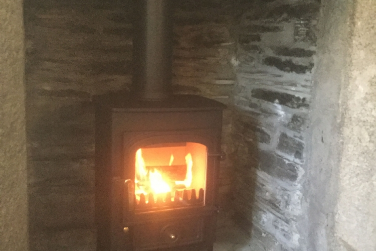 Clearview Pioneer in a Cornish stone fireplace