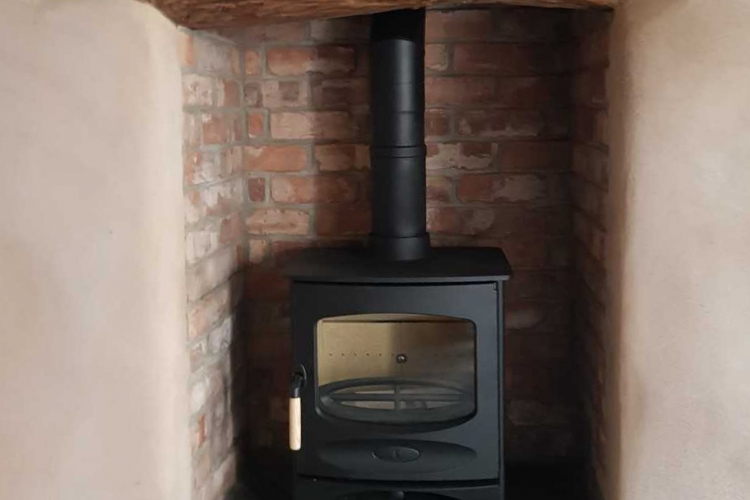 The Charnwood C range in a traditional fireplace