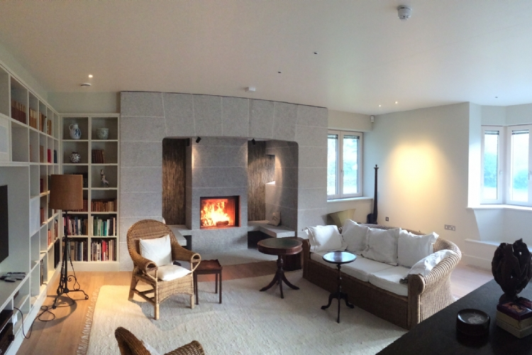 Stuv 21/85 with bespoke granite and slate fireplace