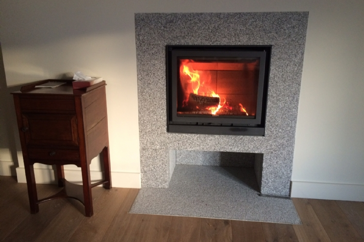 Stuv 16/58 in Bespoke Granite Surround